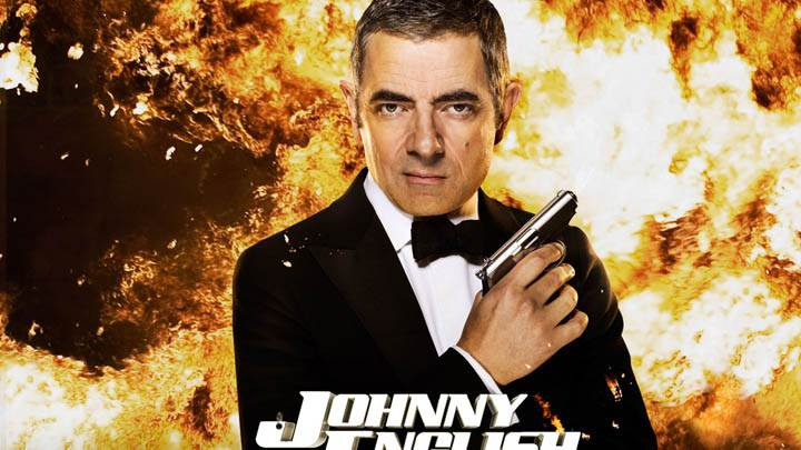Johnny English Reborn – Rowan Atkinson Holding A Gun In Hand