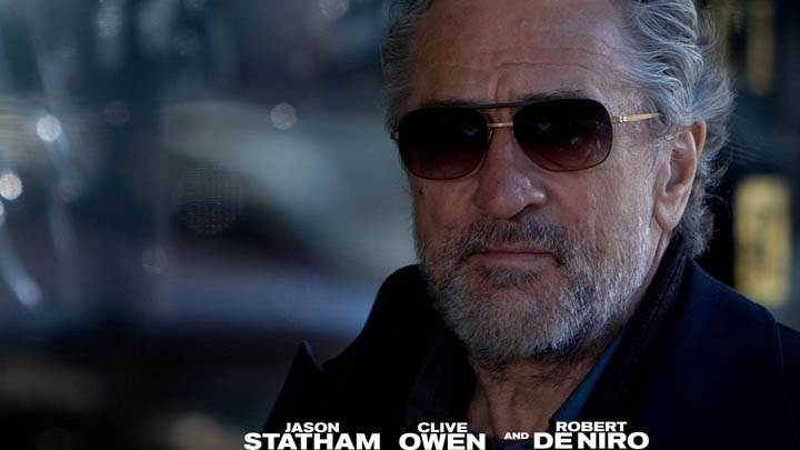 Robert De Niro Wearing Goggles Face Closeup In Killer Elite