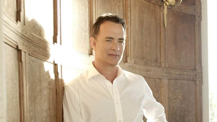 Tom Hanks In A Hall Wearing A White Shirt