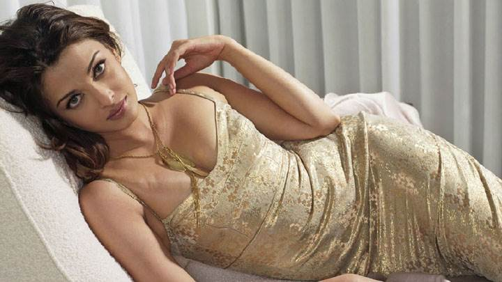 Aishwarya Rai Laying On Sofa In Golden Dress