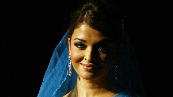 Aishwarya Rai Smile In Blue Dress Black Background