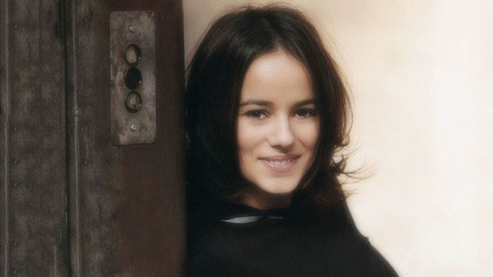 Alizee Jacotey Standing With Elevator In Black Dress