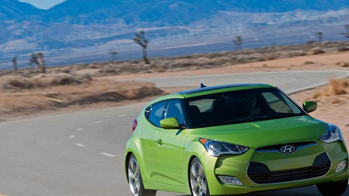 Green Hyundai Veloster On Road