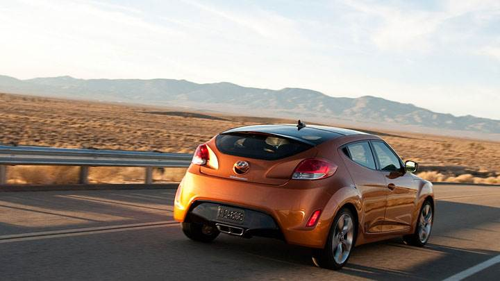 Hyundai Veloster Orange Color Running On Highway
