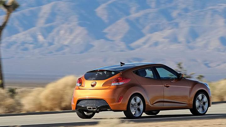 Hyundai Veloster Side Pose On Highway