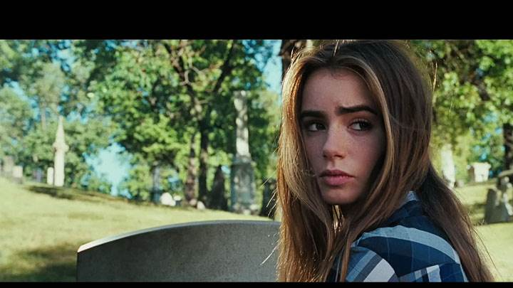 Abduction – Lily Collins Looking Back In Blue Shirt