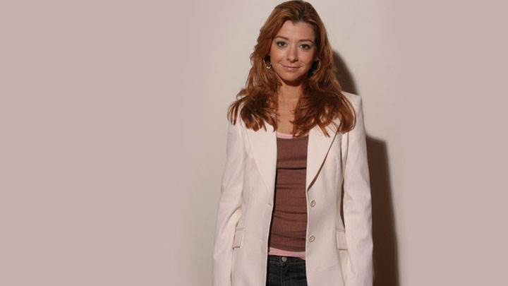 Alyson Hannigan Smiling In White Coat And Blue Jeans