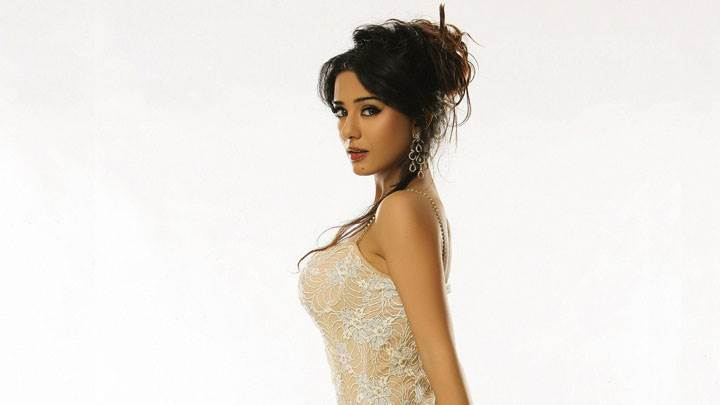 Amrita Rao Side Pose In White Dress And Background