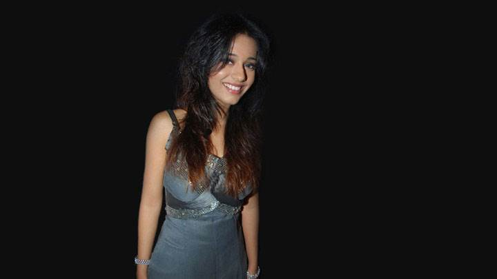 Amrita Rao Smiling In Grey Dress And Black Background