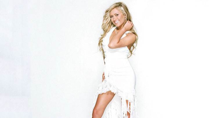Angel Faith Smiling Side Pose In White Dress