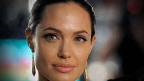 Angelina Jolie In Long Earings Face Closeup