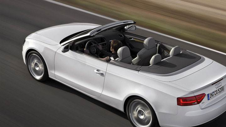 Audi A5 Cabriolet in White Running on Highway