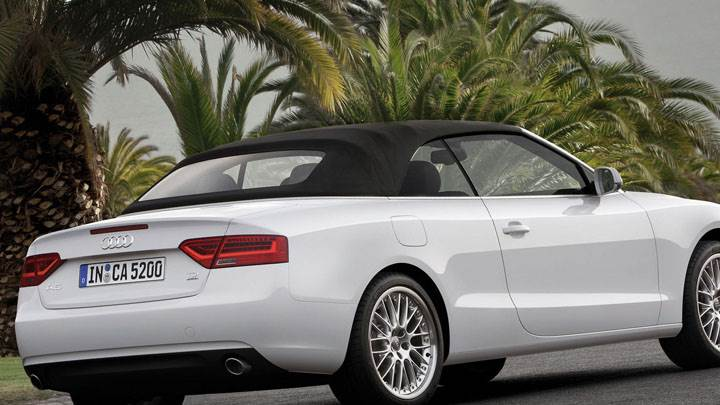 Audi A5 Cabriolet in White Side Back on Road