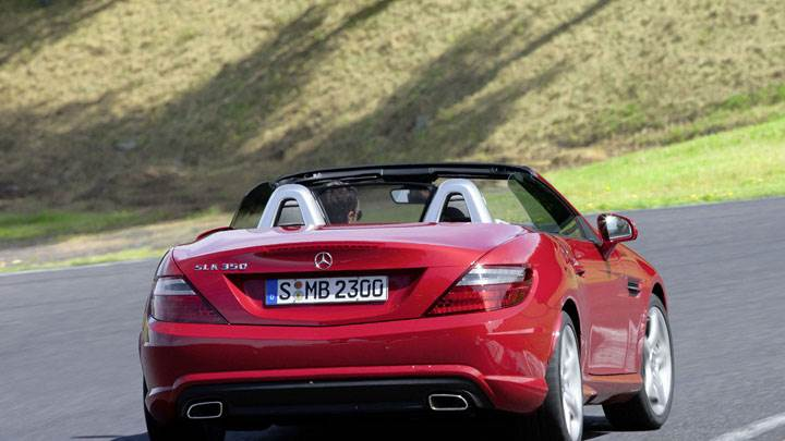 Back Pose of Red Mercedes-Benz SLK 350 On Highway