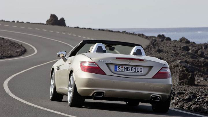 Back View of Golden Mercedes-Benz SLK 350 on Highway