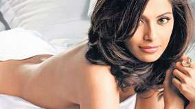 Bipasha Basu Laying Pose And Looking At Camera