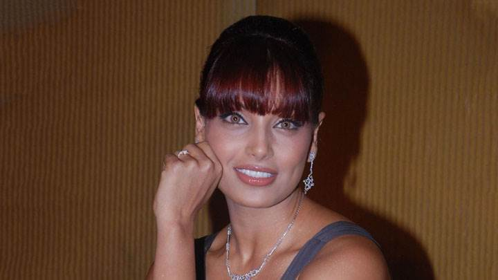 Bipasha Basu Sitting Pose And Brown Eyes