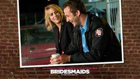 Bridesmaids &#8211; Kristen Wiig And Chris O&#8217;dowd Smiling And Sitting Side View