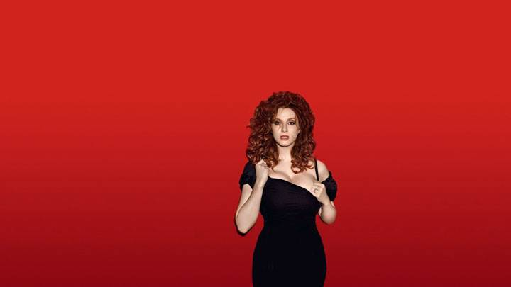 Christina Hendricks In Black Dress And Red Background