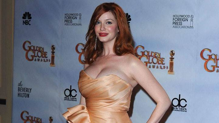 Christina Hendricks Smiling In Yellow Dress At Golden Globe Awards