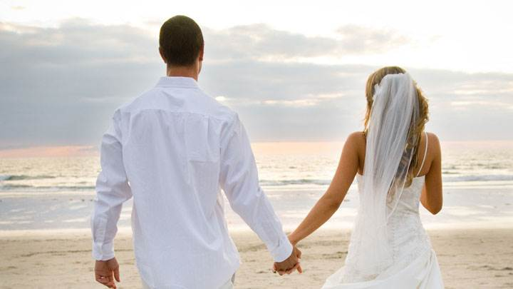 Couple Near Beach After Marriage