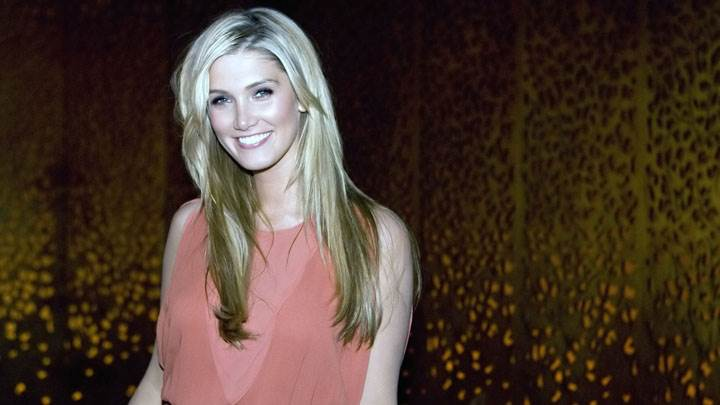Delta Goodrem Smiling In Pink Dress