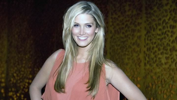 Delta Goodrem Smiling In Pink Dress And Modeling Pose