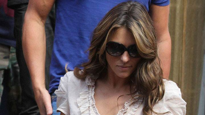 Elizabeth Hurley In White Top And Black Goggles