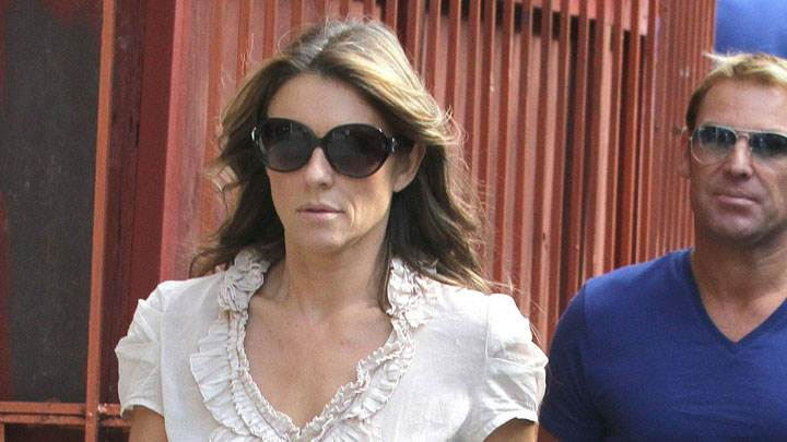 Elizabeth Hurley In White Top And Goggles With Man
