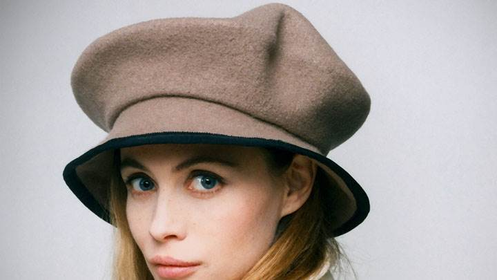 Emmanuelle Beart Wearing Cap Face Closeup