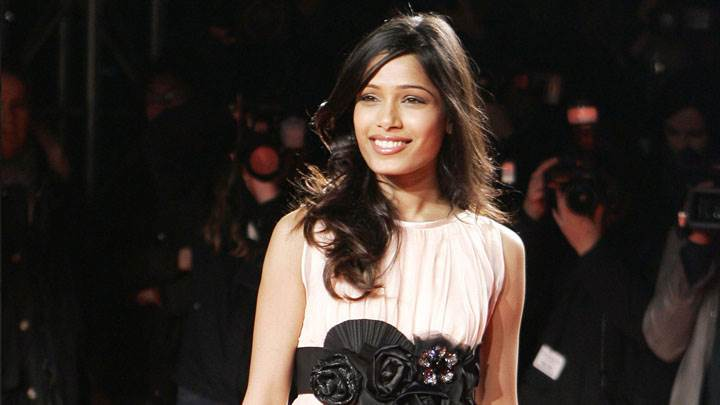 Freida Pinto Smiling in White Dress At Extreme Beauty In Vogue MFW AW