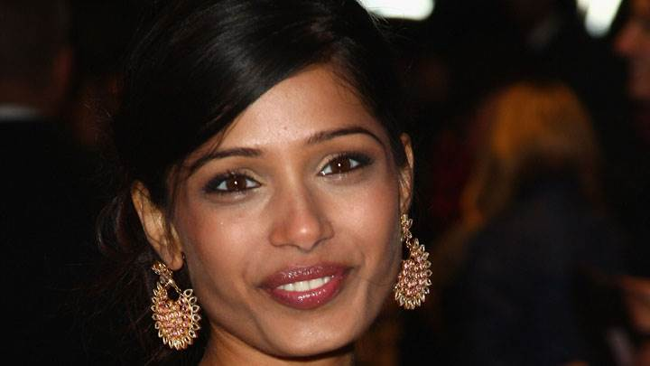 Freida Pinto Golden Earing And Smiling
