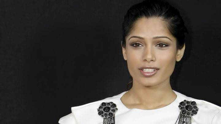 Freida Pinto In White Dress And Black Background