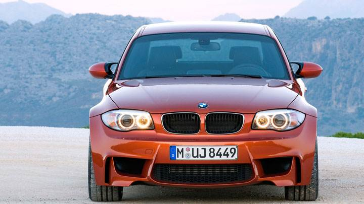 Front Pose of 2011 BMW 1 Series M in Red