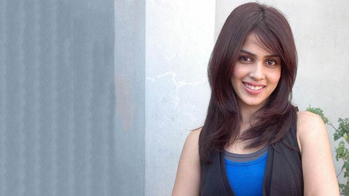 Genelia D'souza Smiling In Black And Blue Top