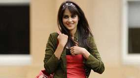 Genelia D'souza Smiling In Red And Green Dress