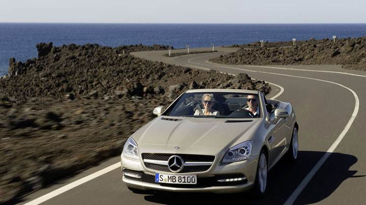 Golden Mercedes-Benz SLK 350 Running On Highway