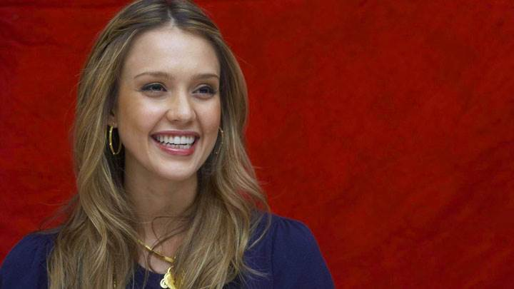 Jessica Alba Laughing In Blue Dress And Red Background