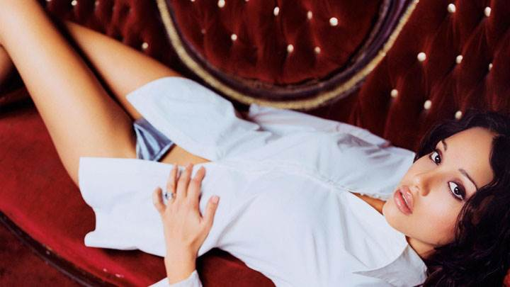 Jessica Alba Laying On Red Sofa In White Dress