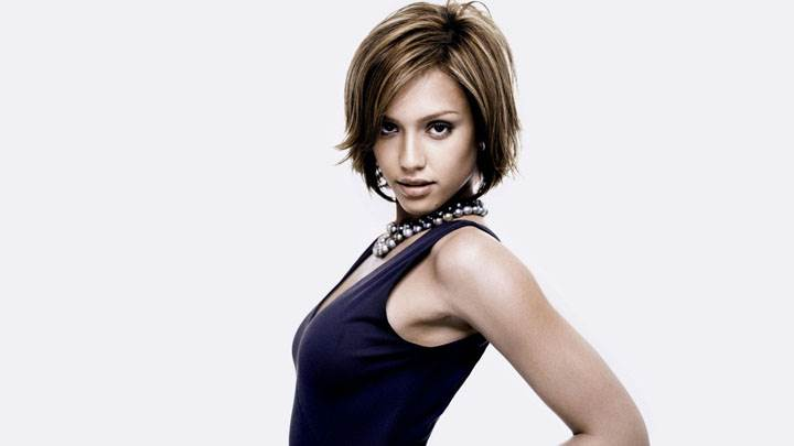 Jessica Alba Modeling Pose In Black Dress And White Background