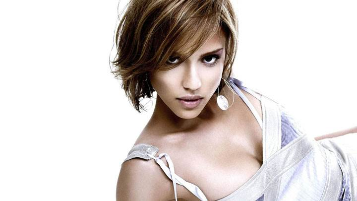 Jessica Alba Laying Pose In White Dress And Background