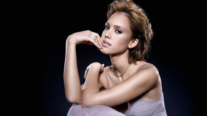 Jessica Alba Sitting In Grey Dress And Black Background