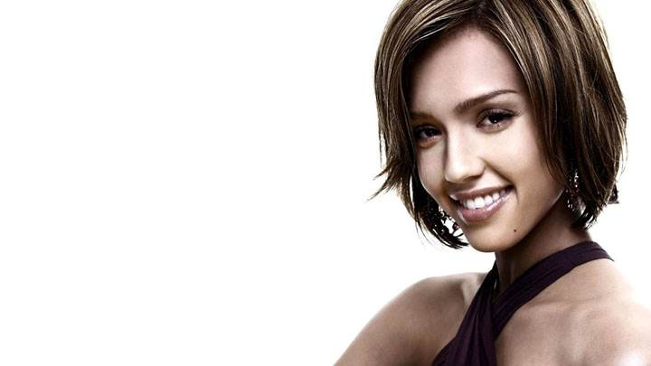 Jessica Alba Smiling In Black Dress And White Background