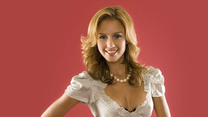 Jessica Alba Smiling In White Dress And Pink Background