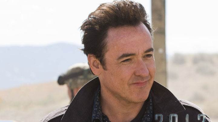 John Cusack Smiling In Black Jacket