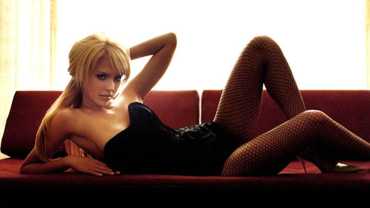 Laying Pose Of Jessica Alba On Red Sofa
