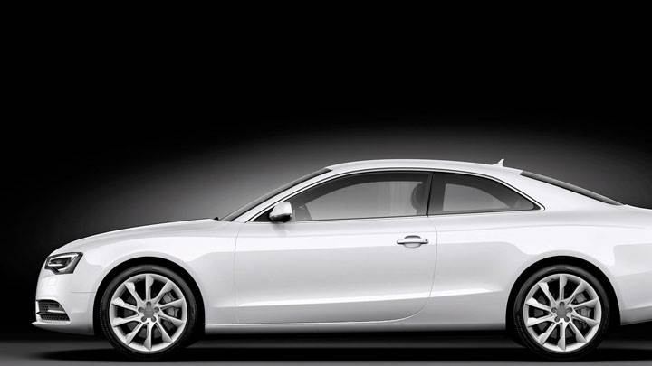 Side Pose of 2012 Audi A5 Coupe in White