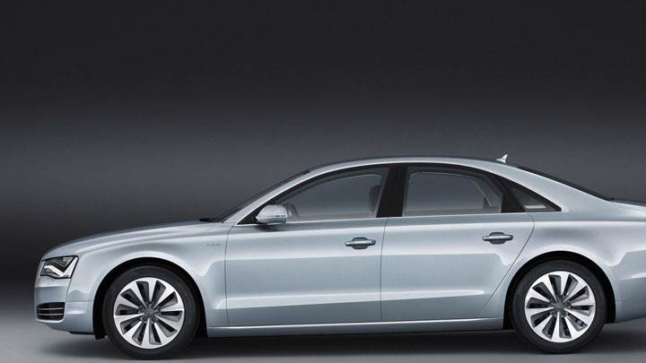 Side Pose of 2012 Audi A8 Hybrid In Green