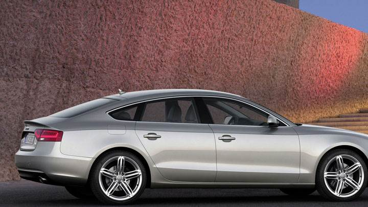 Side Pose of 2012 Audi A5 Sportback Outside Building