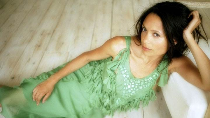 Thandie Newton Laying In Green Dress